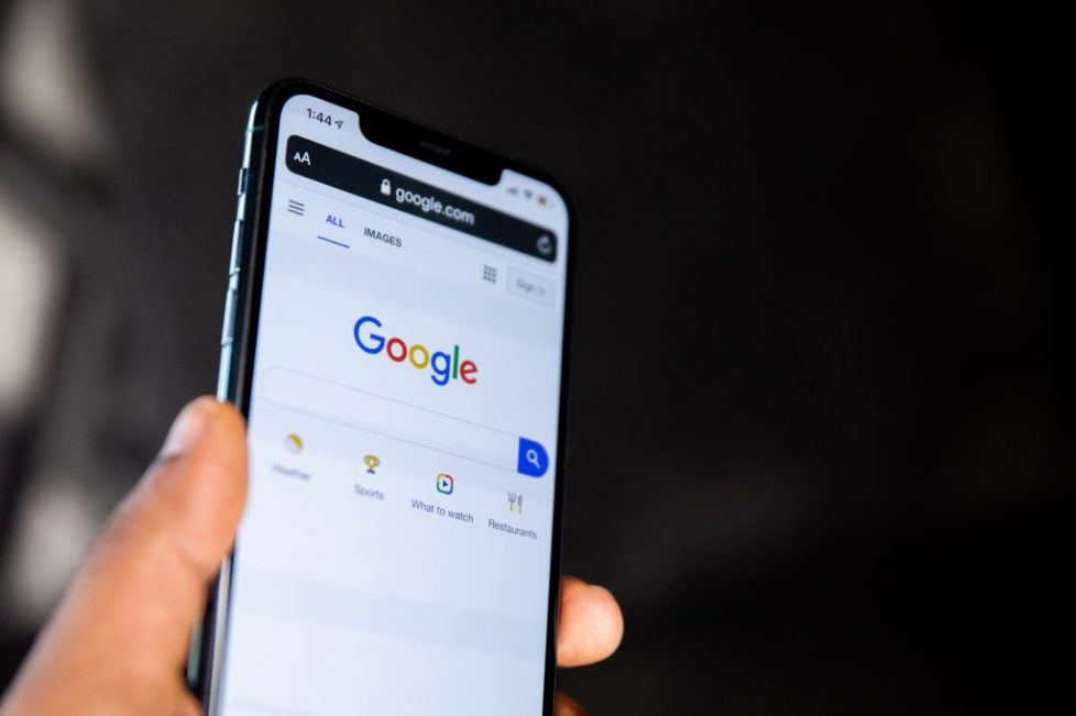 A man holding an iPhone with Google Search | SEO Copywriting